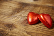 Delicious chocolate hearts on old wood table- focus on heart-sha