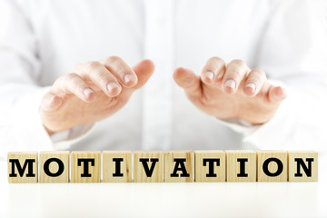 The word Motivation on wooden blocks or cubes