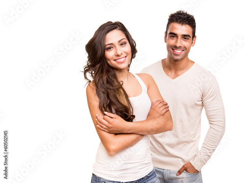 Couple posing over white background