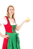 Girl wearing red dirndl and holding tiny chick in her hand
