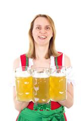 Bavarian waitress serving beer at Oktoberfest