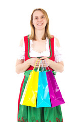 Smiling woman in red dirndl is happy about new clothes