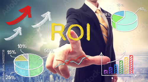 Businessman touching ROI (return on investment)