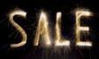 "Sparkling inscription ""sale"" on a black background"