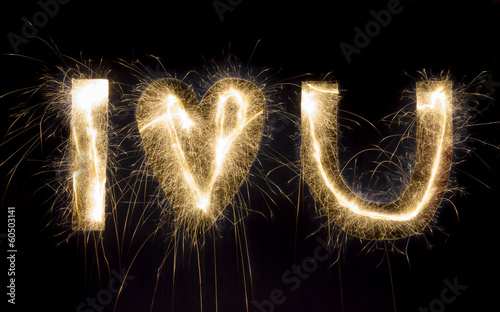 "Sparkling inscription ""I love u"" on a black background"