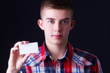 young man showing blank business card