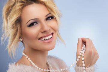 Beautiful blonde girl with Pearls