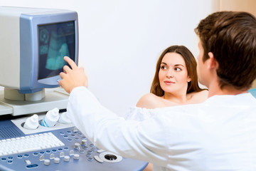 pregnant woman on reception at the doctor