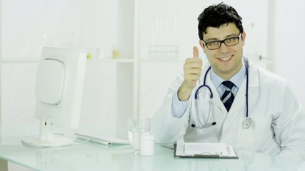 Happy Handsome Medical Doctor Typing on Computer Smiling OK