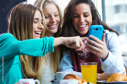 Friends having fun with smartphones