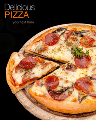Delicious homemade pizza with ham and vegetables.