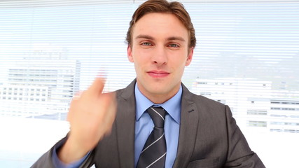 Businessman pointing and talking to camera