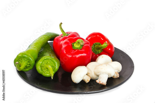 Red and green peppers and some mushrooms.