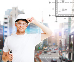 male architect in helmet with blueprint