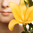beauty woman face with yellow lily flower