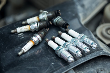 Worn and new spark plugs