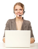 Portrait of business woman working  with headset and laptop.