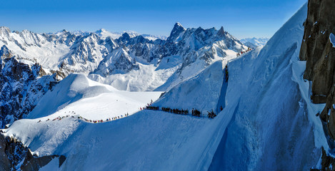 Panorama with skiers heading for Vallee Blanche
