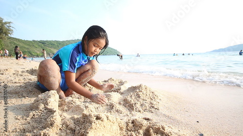 Little girl play on the beach