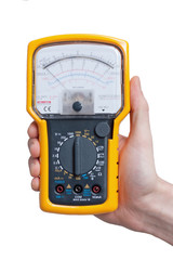 Multimeter with needle pointer in technicians hand