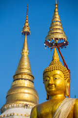 Golden stupa and Buddha statue in a buddhist temple in Thailand
