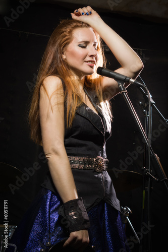 Rock star girl singing in a studio