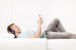 Joyous man listening to music with earphones and resting.