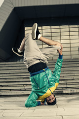 Hip Hop dancer doing head stand