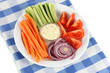 Assorted raw vegetables sticks in plate on napkin close up