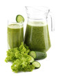 Glass and jug of green vegetable juice with cucumber isolated