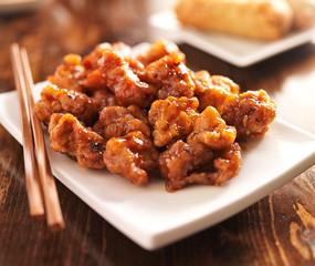 chinese orange chicken with chopsticks