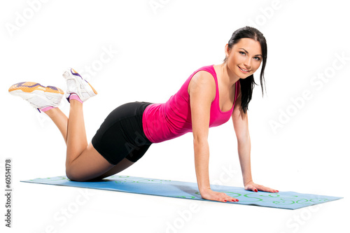Cute brunette on the exercise mat