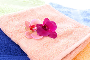 Orchid flower and towels, close-up