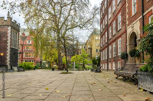 Cobbled Square with Wooden Benches in London