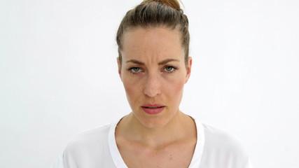 Annoyed woman shouting at camera
