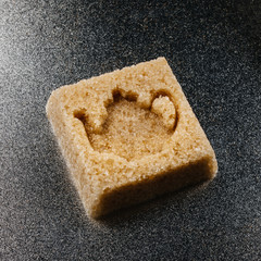 Brown sugar cube with the shape of a english tea or keetle
