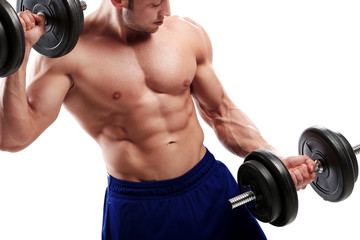 Bodybuilding. Strong man with a dumbbell