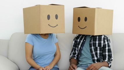 Silly employees with boxes on their heads