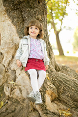 Child next to big tree