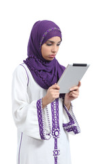 Arab woman bored reading a tablet reader