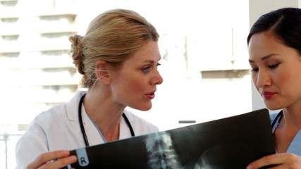 Doctor and nurse looking over xray