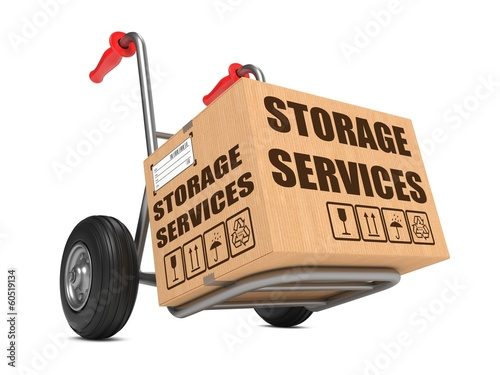 Storage Services - Cardboard Box on Hand Truck.