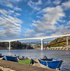 Boats on Douro river and bridges in Porto, Portugal