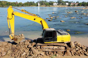 Backhoe loader  working  near river  for protect flood