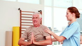 Injured senior citizen exercising with physiotherapist