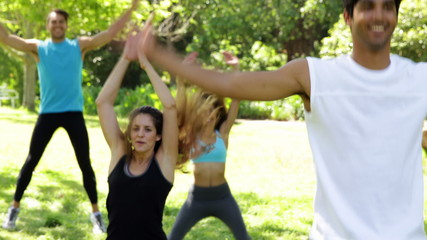 Fitness class doing star jumps in the class