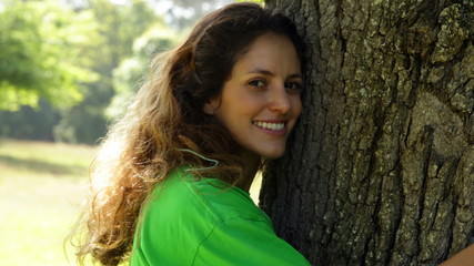 Environmental activist hugging a tree