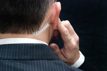Secret Service Agent Listens To Earpiece, Behind