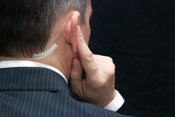 Secret Service Agent Listens To Earpiece, Shoulder