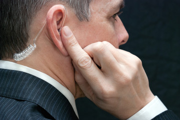 Secret Service Agent Listens To Earpiece, Close Side